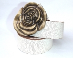 Cracked white strap with brass rose