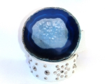 White stud with blue agate